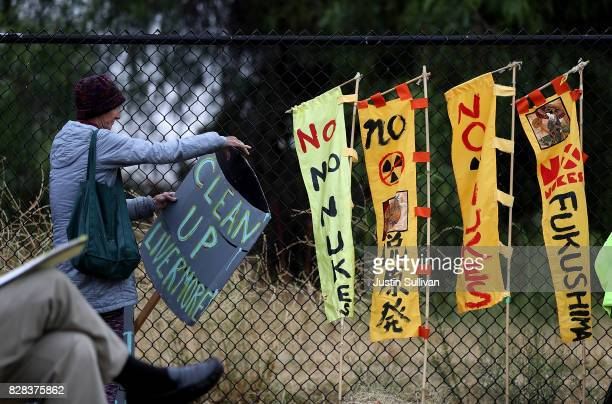 Protester holds a sign during a demonstration against nuclear weapons outside of the Lawrence Livermore National Laboratory on August 9, 2017 in...