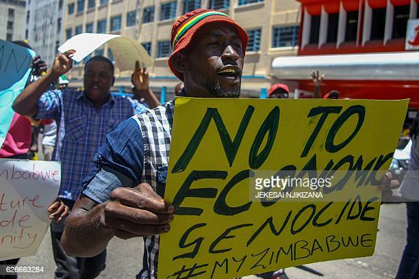 A protester holds a sign during a demonstration by opposition parties against the introduction of bond notes as a currency in Harare on November 30...