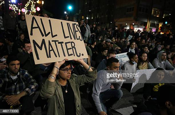 A protester holds a sign during a demonstration on December 8 2014 in Berkeley California protesters have taken to the streets of Berkeley for a...