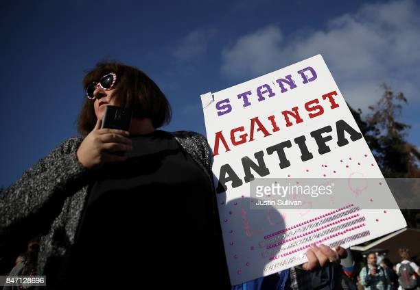 A protester holds a sign during a demonstration outside of Zellerbach Hall on the UC Berkeley campus on September 14 2017 in Berkeley California...