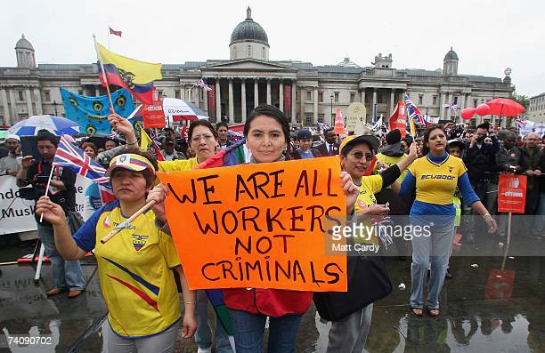 A protester holds a sign during a march hoping to draw attention to claims of exploitation and discrimination of migrant workers in Trafalgar Square...