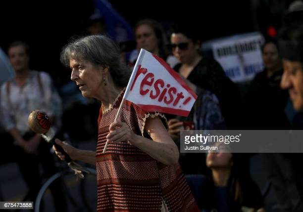 A protester holds a sign during a May Day demonstration outside of a US Immigration and Customs Enforcement office on May 1 2017 in San Francisco...