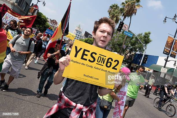 A protester holds a sign during Enough is Enough protest in Los Angeles California August 27 2016 People gathered to protest a variety of issues...