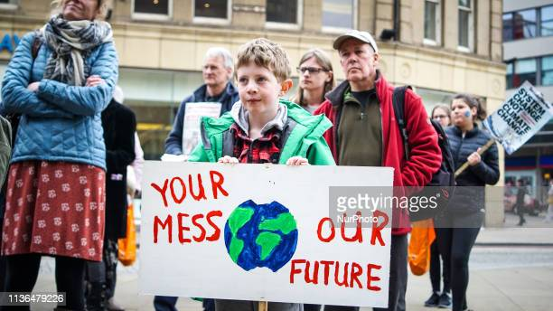 A protester holds a sign during the protest YouthStrike4Climate in Sheffield England 12 April 2019 Thousands students take part across the country to...