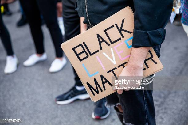A protester holds a sign in support of Black Lives Matter during a march in Boystown on June 14 2020 in Chicago Illinois Protests erupted across the...