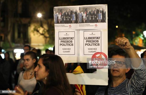 A protester holds a sign reading 'Freedom to political prisoners' during a demonstration at Placa de la Vila de Gracia in Barcelona on November 2...