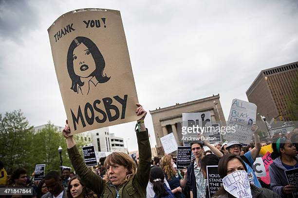 A protester holds a sign reading Thank you Mosby during a march May 1 2015 in Baltimore Maryland Maryland state attorney Marilyn J Mosby announced...