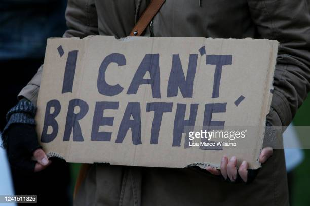 A protester holds a sign with the words 'I can't breathe' written on it during a 'Black Lives Matter' rally in Hyde Park on June 02 2020 in Sydney...