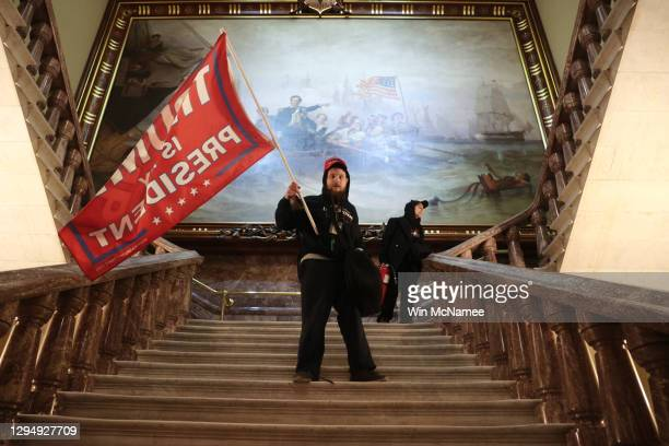 Protester holds a Trump flag inside the US Capitol Building near the Senate Chamber on January 06, 2021 in Washington, DC. Congress held a joint...