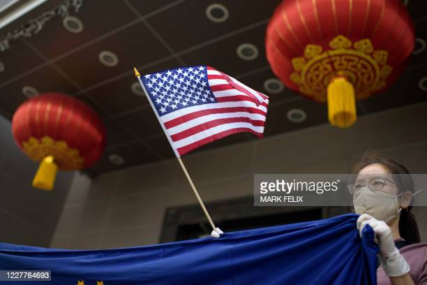 Protester holds a US flag outside of the Chinese consulate in Houston on July 24 after the US State Department ordered China to close the consulate....