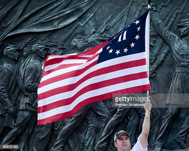 A protester holds a version of the Betsy Ross American flag during the Tea Party Express rally on September 12 2009 in Washington DC Thousands of...