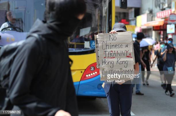 A protester holds an antiChina sign during a protest in the Sham Shui Po district in Hong Kong on October 1 as the city observes the National Day...