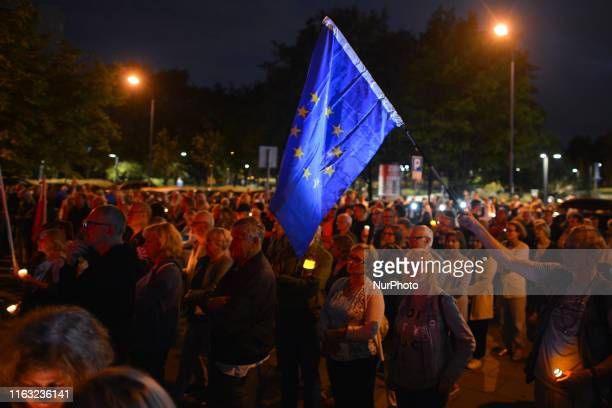 A protester holds an EU flag Members of the Committee for the Defence of Democracy and members of the Polish opposition parties seen outside Krakow's...