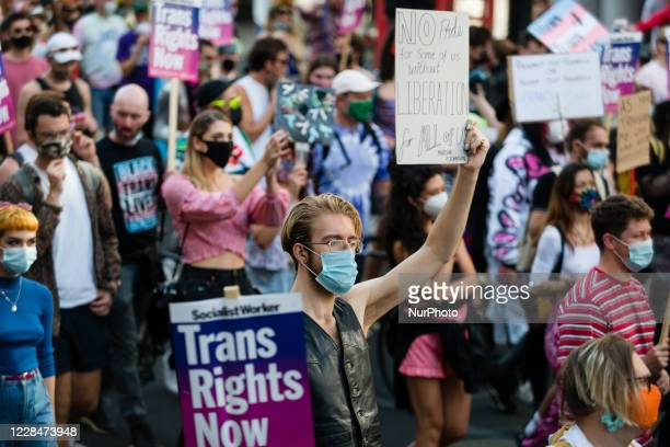 Protester holds banner during London Trans Pride in London, Britain, 12 September 2020. London Trans+ Pride 2020 is a direct response to the...