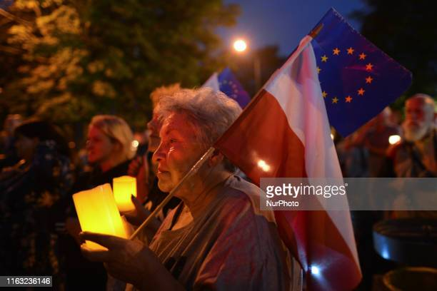 A protester holds EU and Polish flags Members of the Committee for the Defence of Democracy and members of the Polish opposition parties seen outside...