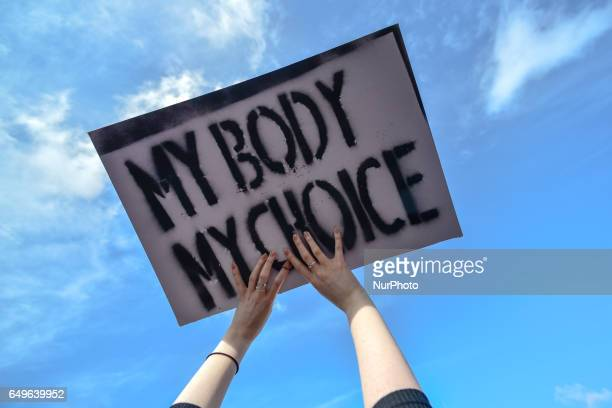 A protester holds 'My Body My Choice' sign' as hundreds of people mainly members of the Strike 4 Repeal campaign gathered on O'Connel Bridge in...