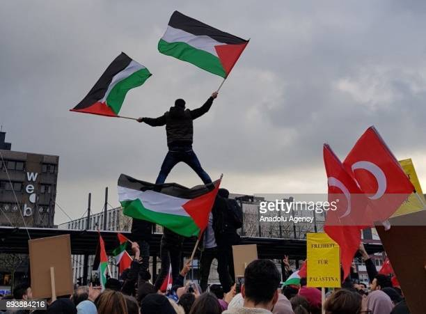 Protester holds Palestinian flags during a demonstration against US President Donald Trumps announcement to recognize Jerusalem as the capital of...