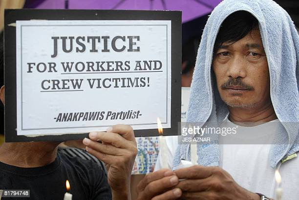 A protester holds placard during a candle light protest in front of the Sulpicio Lines office in Manila on July 2 2008 the owner of illfated ferry...