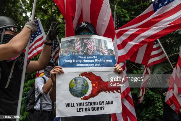 Protester holds placards as he takes part in a march to the U.S consulate during a demonstration on September 8, 2019 in Hong Kong, China....