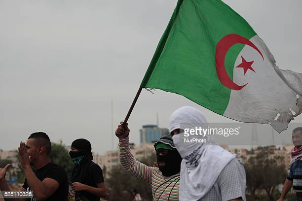 Protester holds the Algerian flag during demonstration near Ramallah city Clashes erupted between hundreds of Palestinian protesters and Israeli...