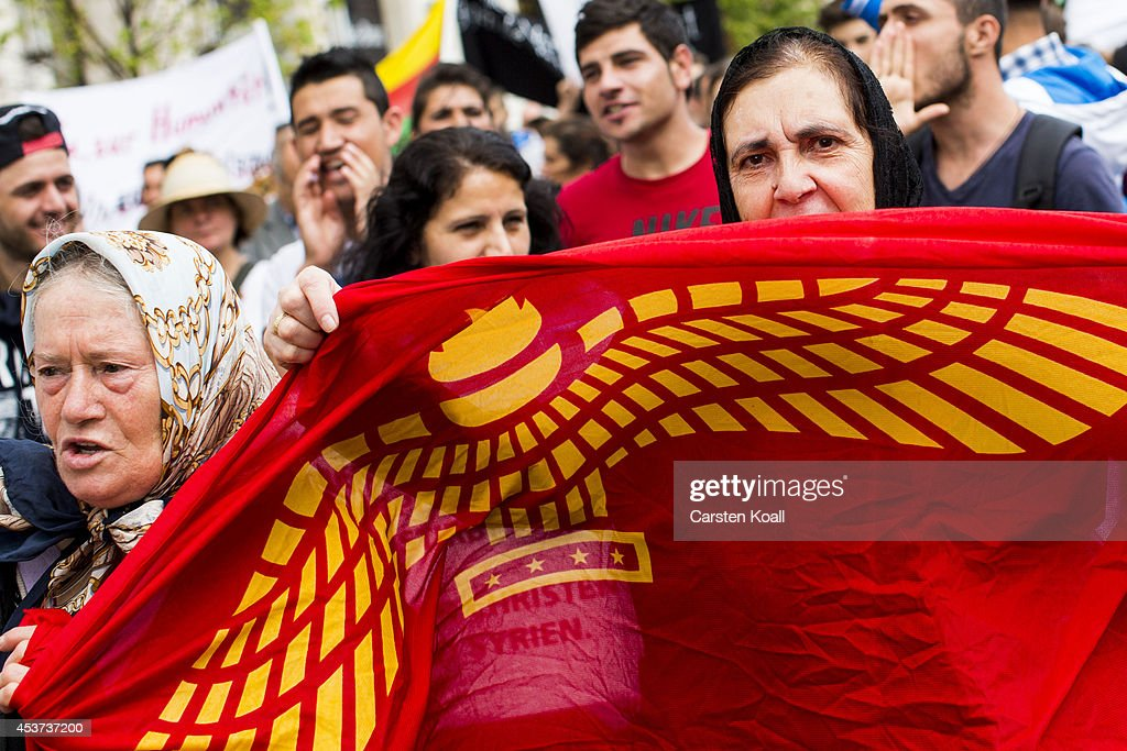 A protester holds the aramaic flag as more then thousand participants of several oriental christian groups gather to protest against the ongoing violence against their brethren in Iraq and Syria by ISIS fighters on August 17, 2014 in Berlin, Germany. Tens of thousands of Yazidis, who practice their own religion and are neither Christian nor Muslim have fled targeted violence from ISIS Muslim Sunni fighters in the region of northern Iraq that borders Syria and Kurdish regions. ISIS has targeted Christians and Shia Muslims as well.