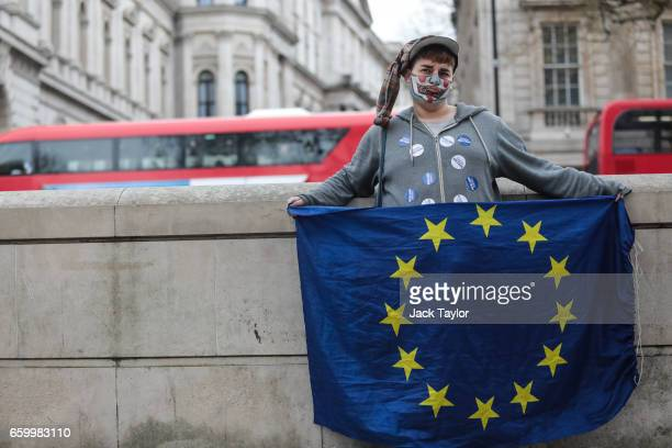A protester holds the flag of Europe during a demonstration outside of Downing Street on March 29 2017 in London England Later today British Prime...