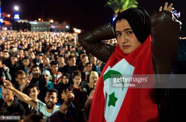 A protester holds the flag of the Rif Republic as protesters shout slogans in the northern city of Al Hoceima on October 30 following the death of...