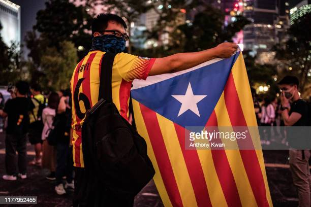A protester holds up a a Catalan proindependence Estelada flag during the Hong Kong Catalonia solidarity gathering in Central district on October 24...