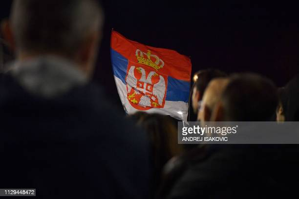 A protester holds up a flag of Serbia during a demonstration against the Serbian President on March 9 2019 Since early December demonstrators have...