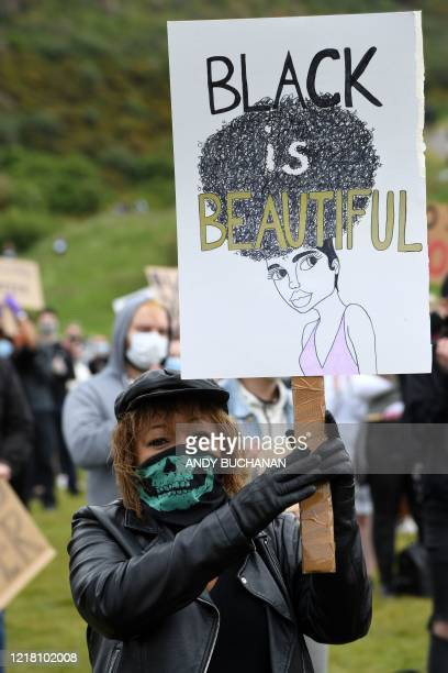 A protester holds up a placard at a demonstration in Edinburgh on June 7 organised to show solidarity with the Black Lives Matter movement in the...