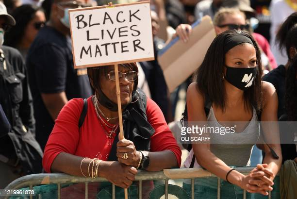 Protester holds up a placard at a gathering in support of the Black Lives Matter and Black Voices Matter movements in central Leeds in northern...