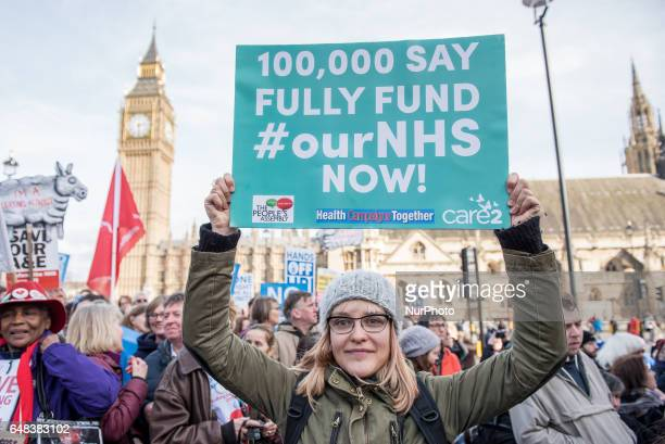 A protester holds up a placard during a demonstration in support of the NHS in Tavistock Square on March 4 2017 in London England Thousands march...