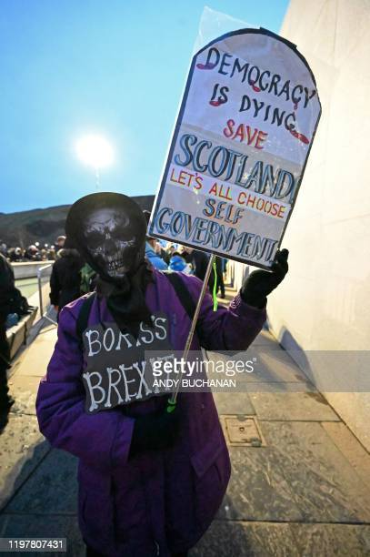 Protester holds up a placard during a protest by anti-Brexit activists in Edinburgh on January 31, 2020. - Britain on January 31 ends almost half a...