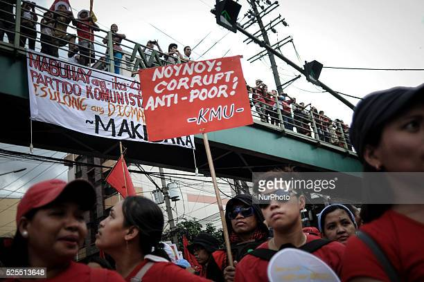 A protester holds up a placard with the words 'Noynoy corrupt antipoor' during a demonstration outside the presidential palace in Manila Philippines...