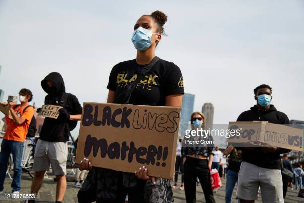 A protester holds up a sign as people gather during an antiracism rally in solidarity with the protests in the US on June 3 2020 in Rotterdam...