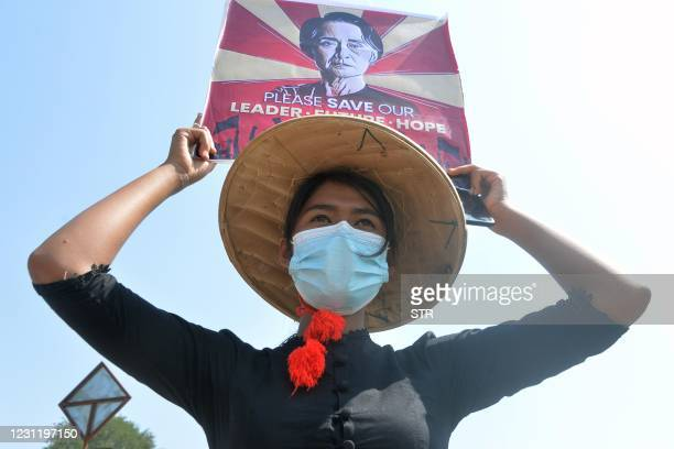 Protester holds up a sign calling for the release of detained Myanmar civilian leader Aung San Suu Kyi during a demonstration against the military...