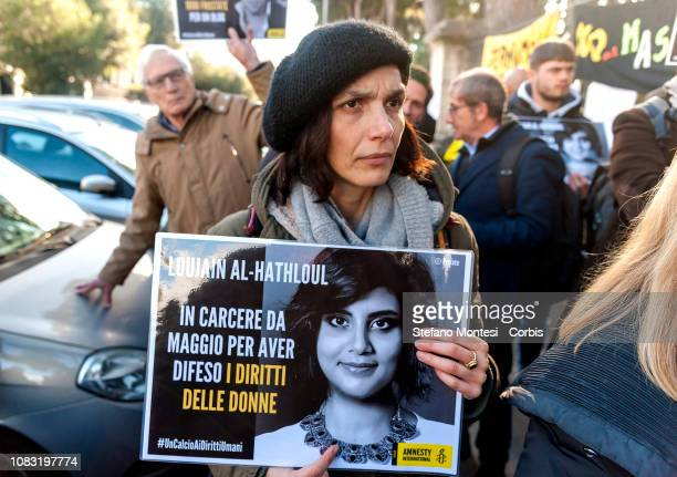 A protester holds up a sign during a protest planned by organisations including the Order of Journalists and Amnesty International Italy against the...