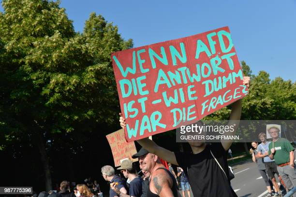 A protester holds up a sign reading 'If AFD is the answer how stupid was the question' at the start of a twoday party congress of Germany's farright...