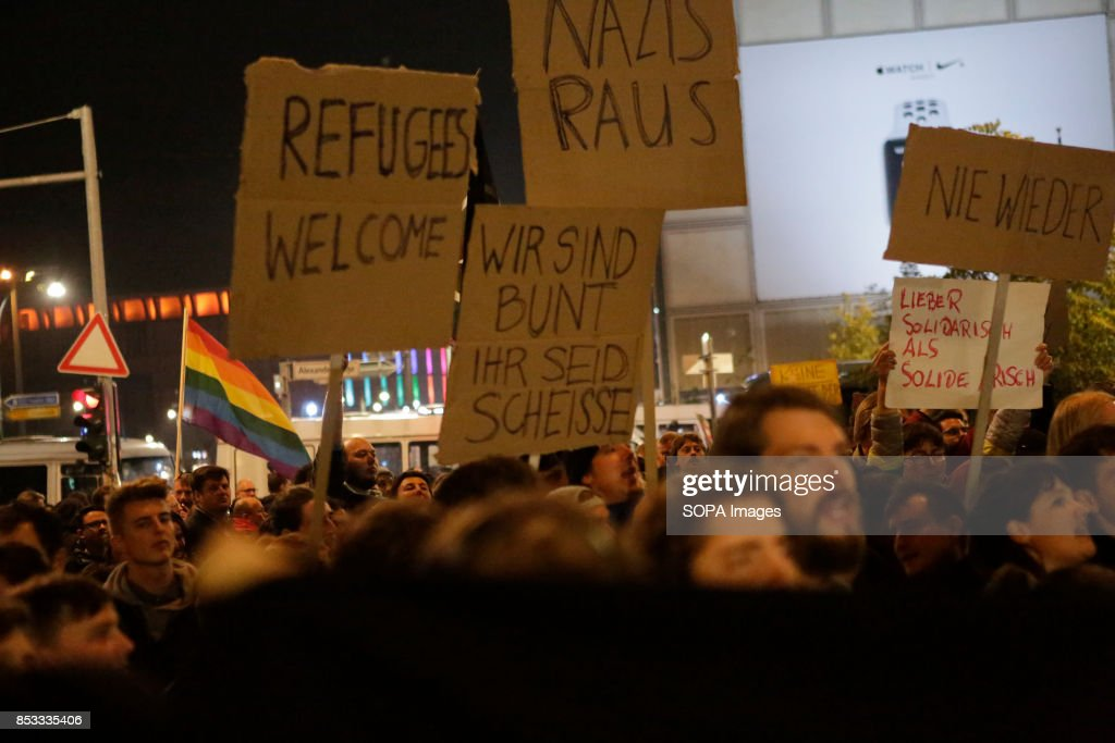 Protester holds up a sign that reads 'Refugees Welcome', ' : News Photo