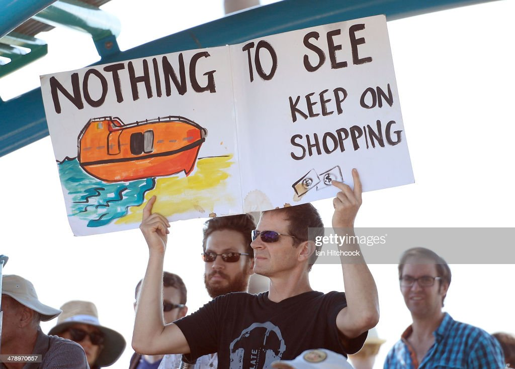 A protester holds up a sign to demonstrate against the Abbott led Coalition Government on March 16, 2014 in Townsville, Australia. March In March is a nationwide grassroots protest organized to deliver a statement of no confidence in the current Australian Government.