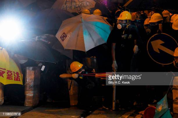 Protester holds up a slingshot during a demonstration in the area of Sheung Wan on July 28, 2019 in Hong Kong, China. Pro-democracy protesters have...