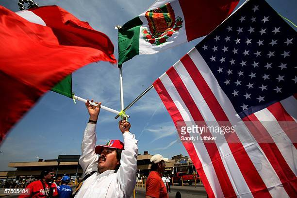 A protester holds US and Mexican flags during a demonstration during a rally at the MexicoUnited States Port of Entry in Tijuana Mexico May 1 2006...