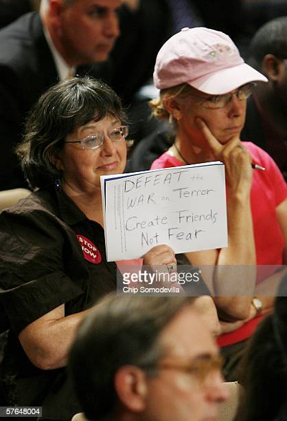 A protester in the audience holds up a sign during the confirmation hearing for Gen Michael Hayden nominee for the Director of the Central...