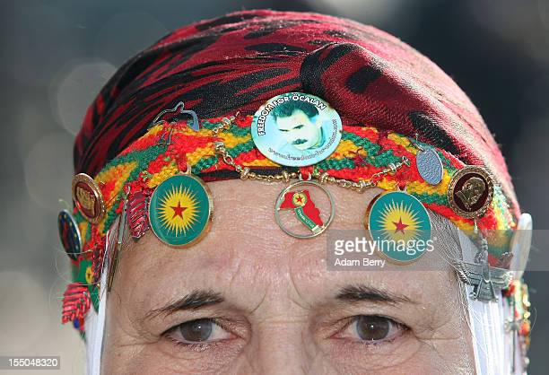 A protester in traditional Kurdish dress demonstrates in front of the Brandenburg Gate against the state visit of Turkish Prime Minister Recep Tayyip...