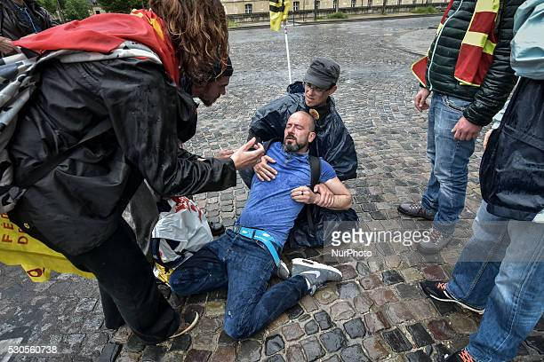 Protester injured by tear gas during clashes with police during a demonstration of railway workers of French state rail operator SNCF near the gare...