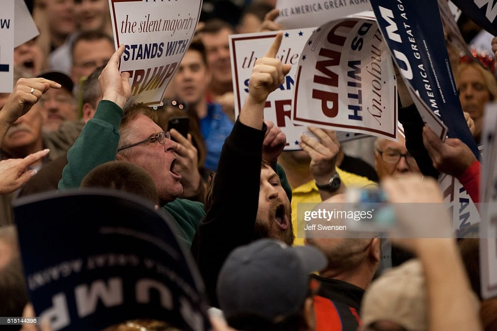 A protester interrupts as Republican presidential candidate Donald Trump speaks at a campaign event at the I-X Center March 12, 2016 in Cleveland, Ohio.