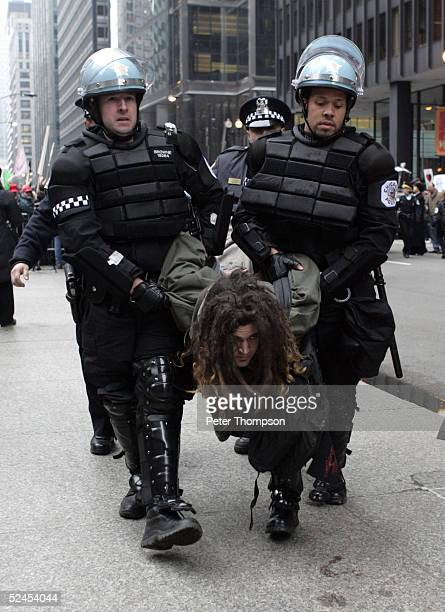 A protester is arrested after refusing to move from the street during a war protest on Dearborn Street March 19 2005 in Chicago Illinois...
