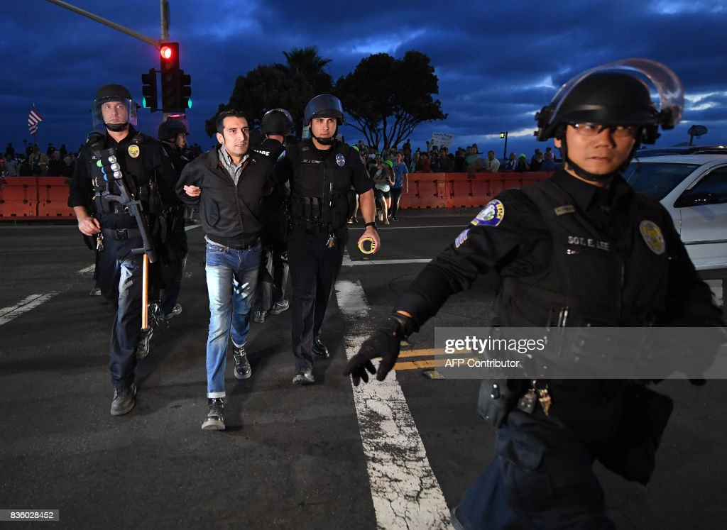 A protester is arrested after the 'America First' group clashed with counter protesters during dual rallies in Laguna Beach, California, on August 20, 2017. /