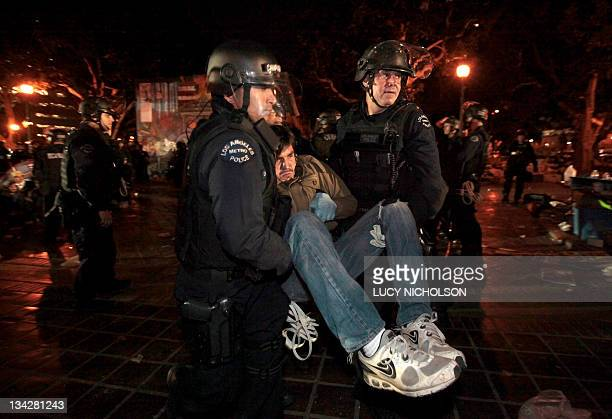 A protester is arrested as Los Angeles police officers at the Occupy Los Angeles encampment outside City Hall on November 30 2011 Hundreds of riot...