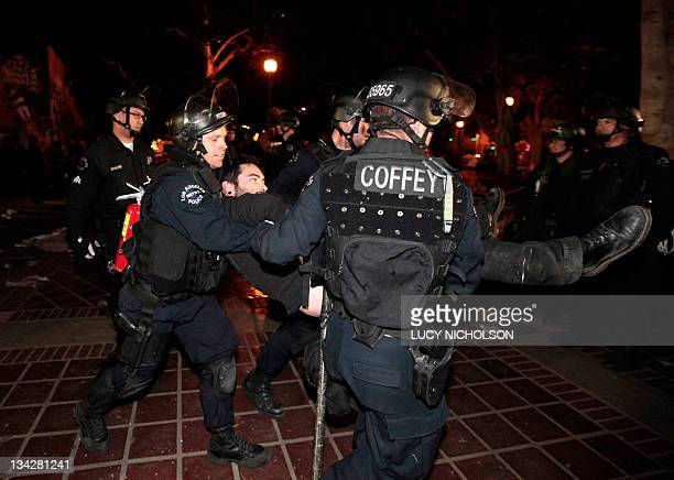 A protester is arrested as Los Angeles police officers dismantle the Occupy Los Angeles encampment outside City Hall on November 30 2011 Hundreds of...